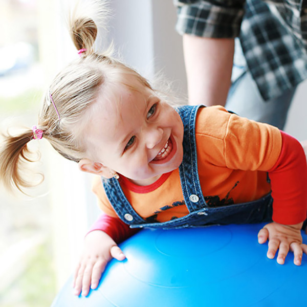 Baby in high chair looking up